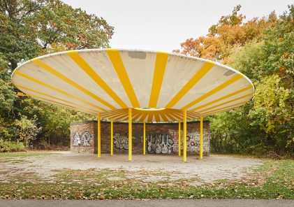Yellow striped UFO shaped concrete structure