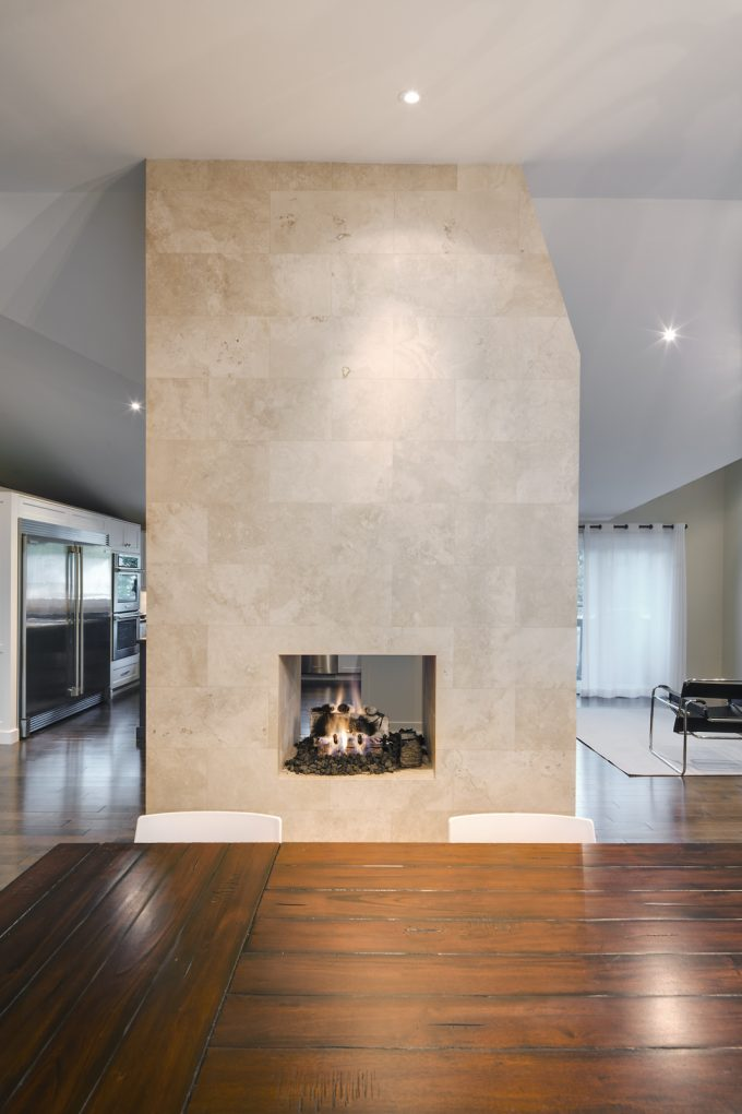 A recessed fire place in the interior of a house