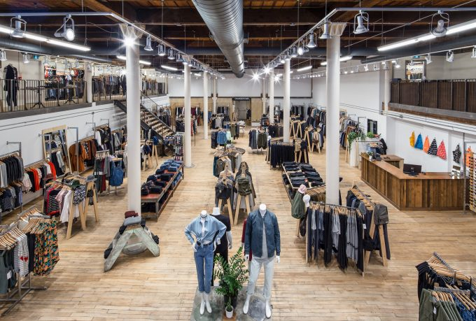 Clothing store interior with high ceilings and columns