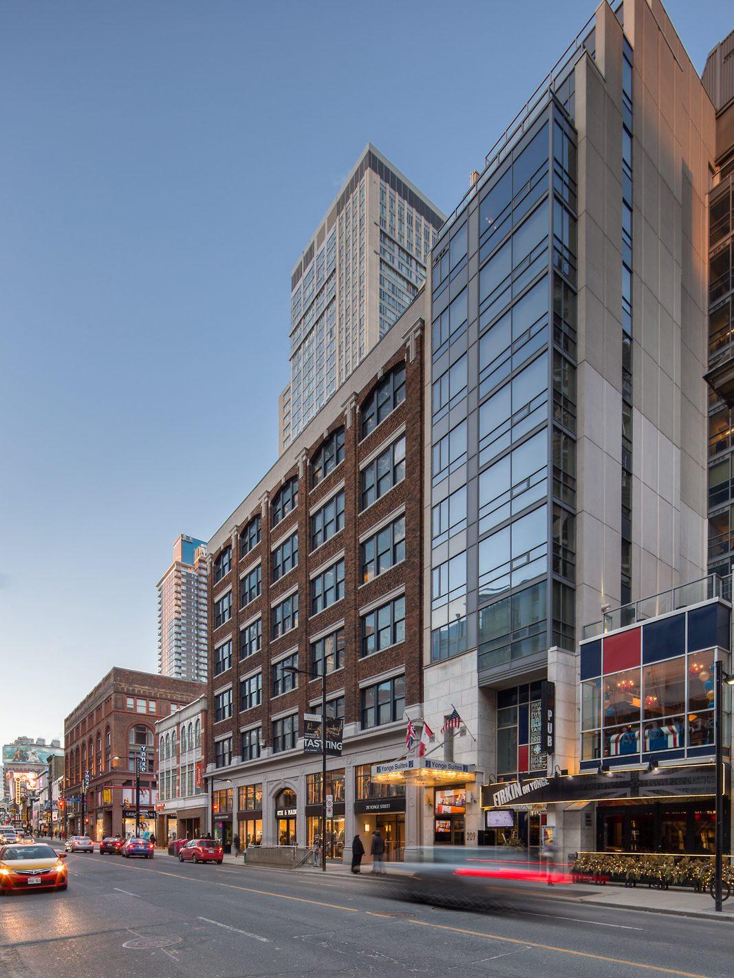 Street view of midrise brick building
