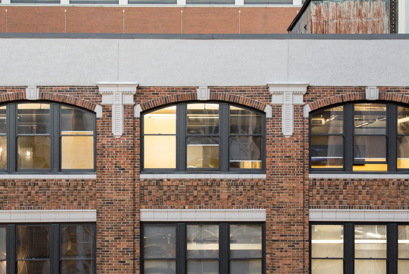 Ornamental details on exterior of a brick building