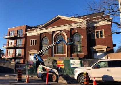 Construction underway restoring the facade of 14 Dewhurst for Sunday School Lofts