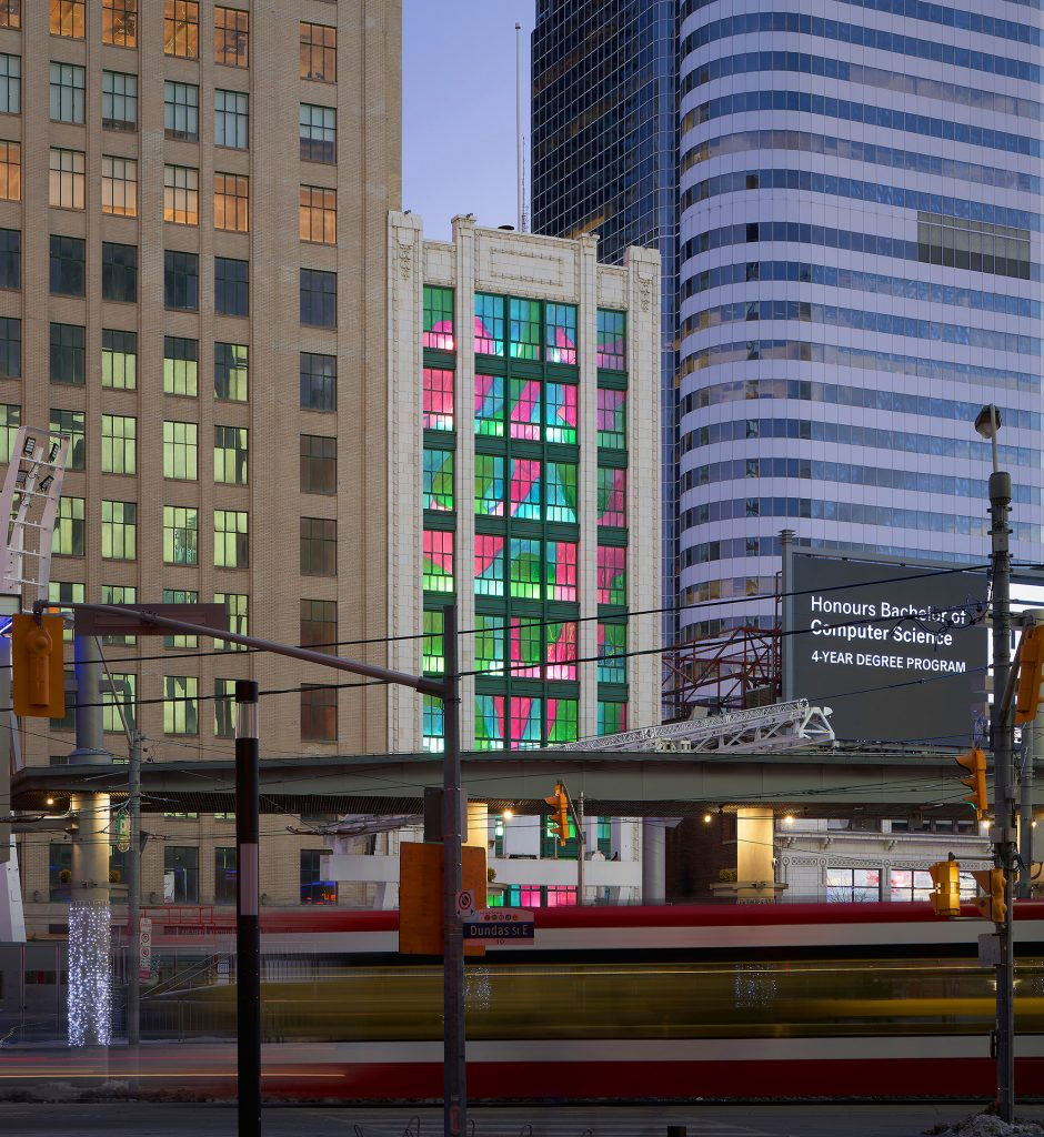 View of installation from across Dundas Square with streetcar passing in forground