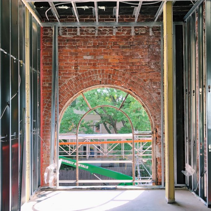 An open arched window in a brick structure