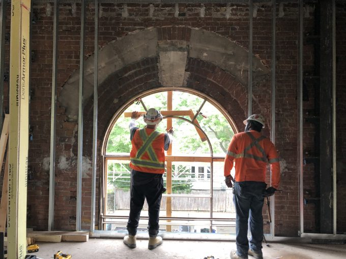Arched window frames under construction