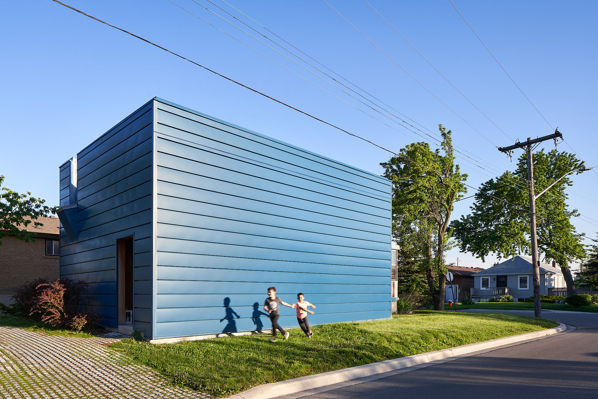 Blue building attached to existing suburbanhome