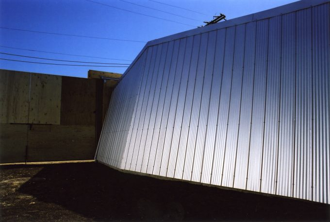 Night view of corrugated white shed panel